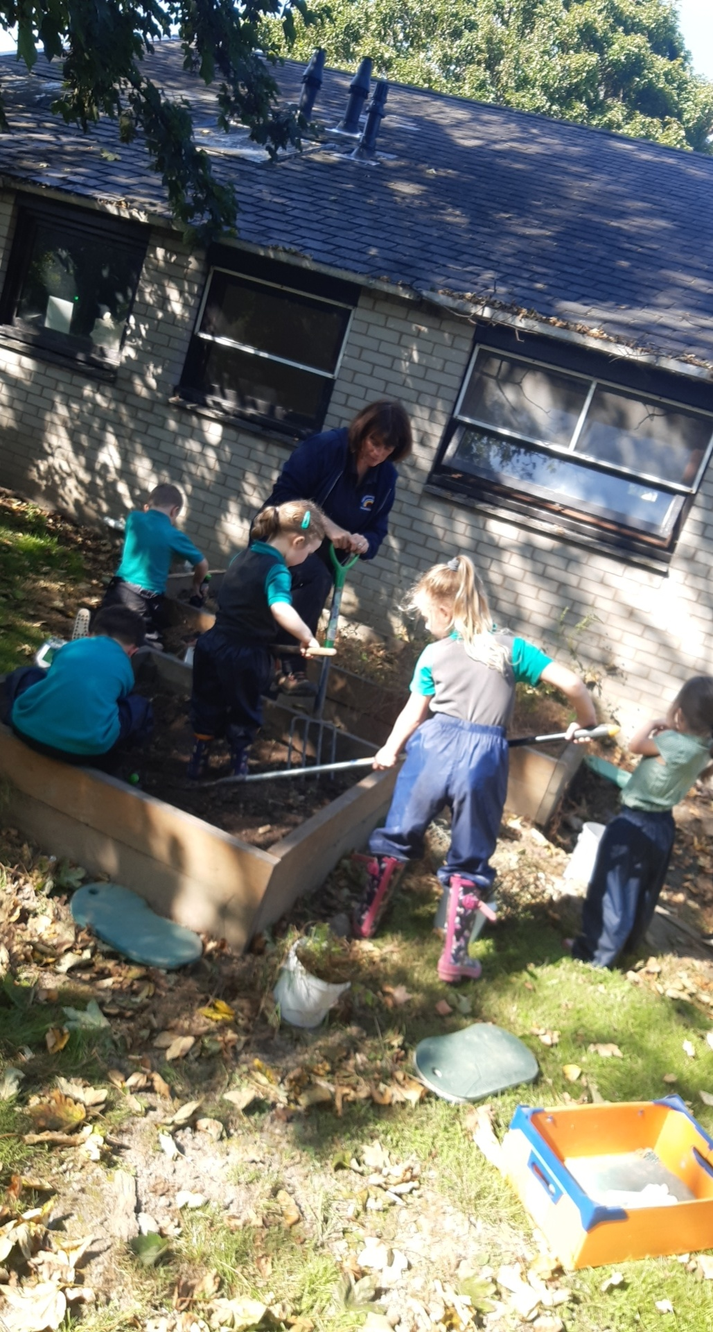 A group of kids working in the garden
