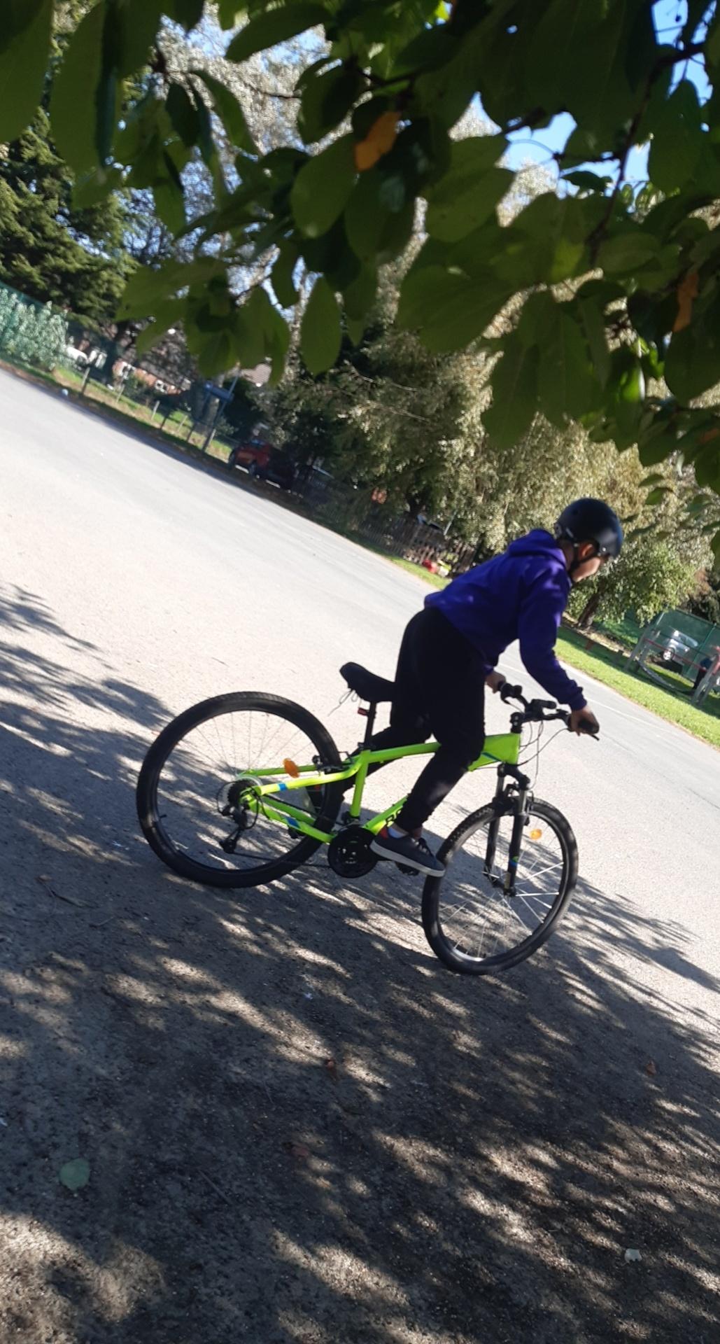 A young boy on a bike